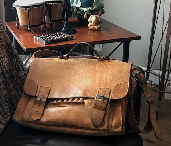Worn out leather messenger bag