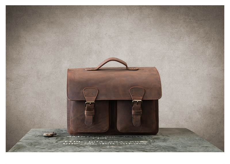 Brown leather satchel with 3 compartments on vintage box.