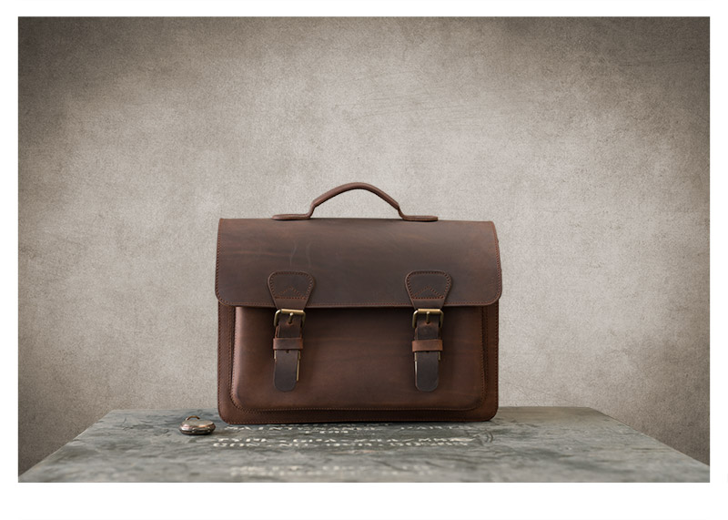 Beautiful brown leather satchel on vintage box.