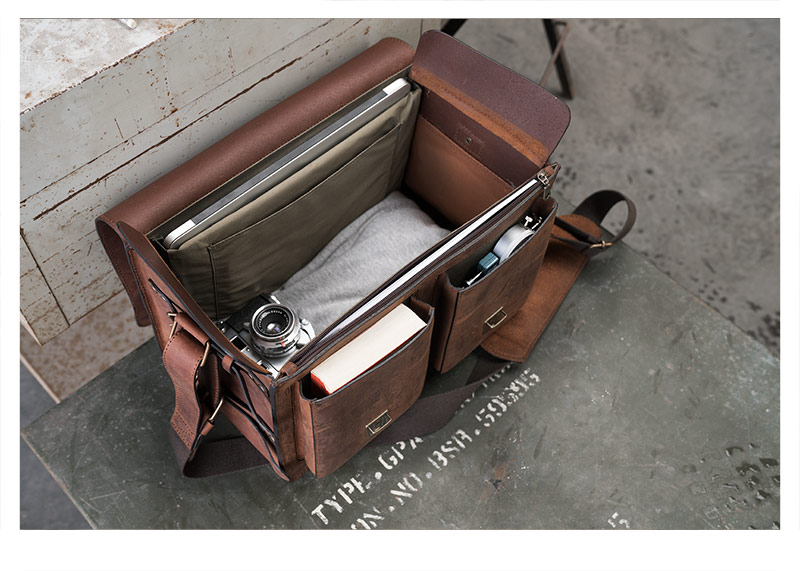 Large empty leather bag on military box.