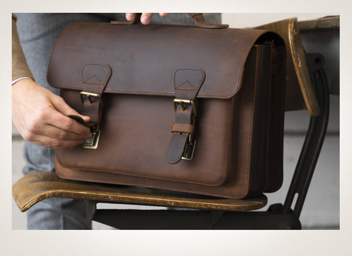 Our satchels are fitted with practical and secure push locks.