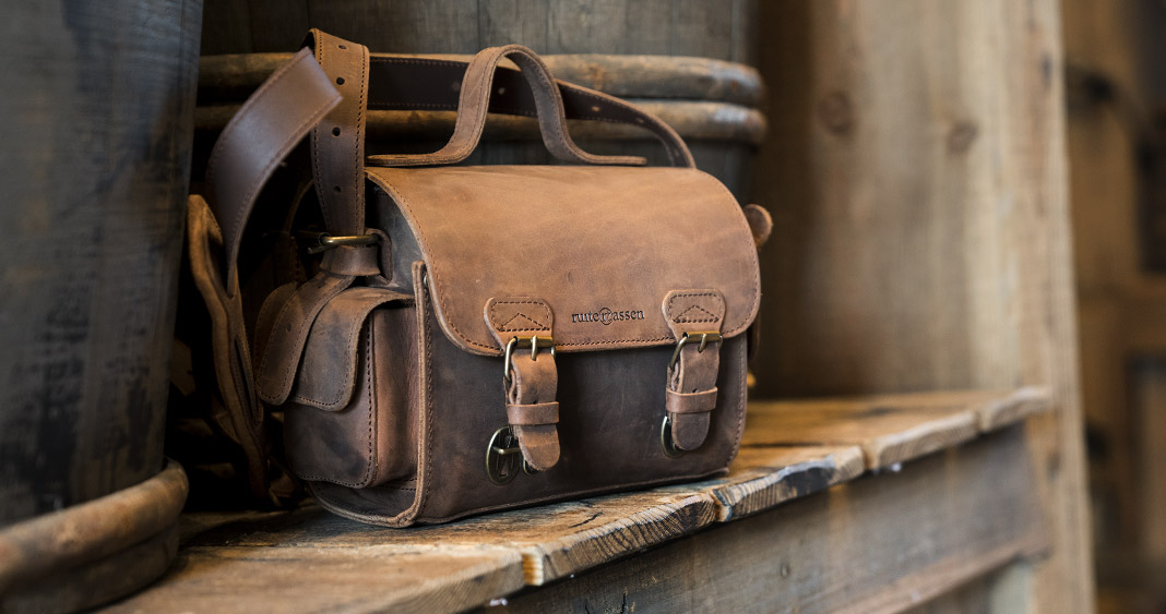 Small brown leather camera bag.