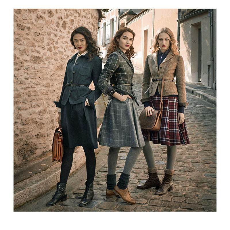 Women wearing vintage clothing and leather bags.