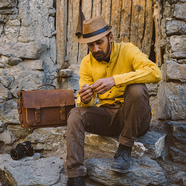 Man with vintage brown leather bag.
