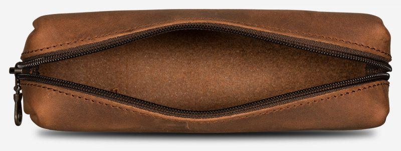 Brown leather pencil bag interior.