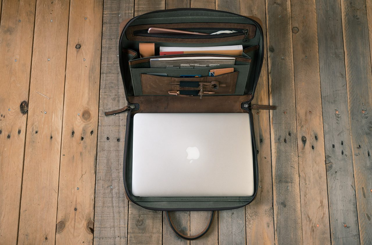 Portfolio briefcase opened with accessories.