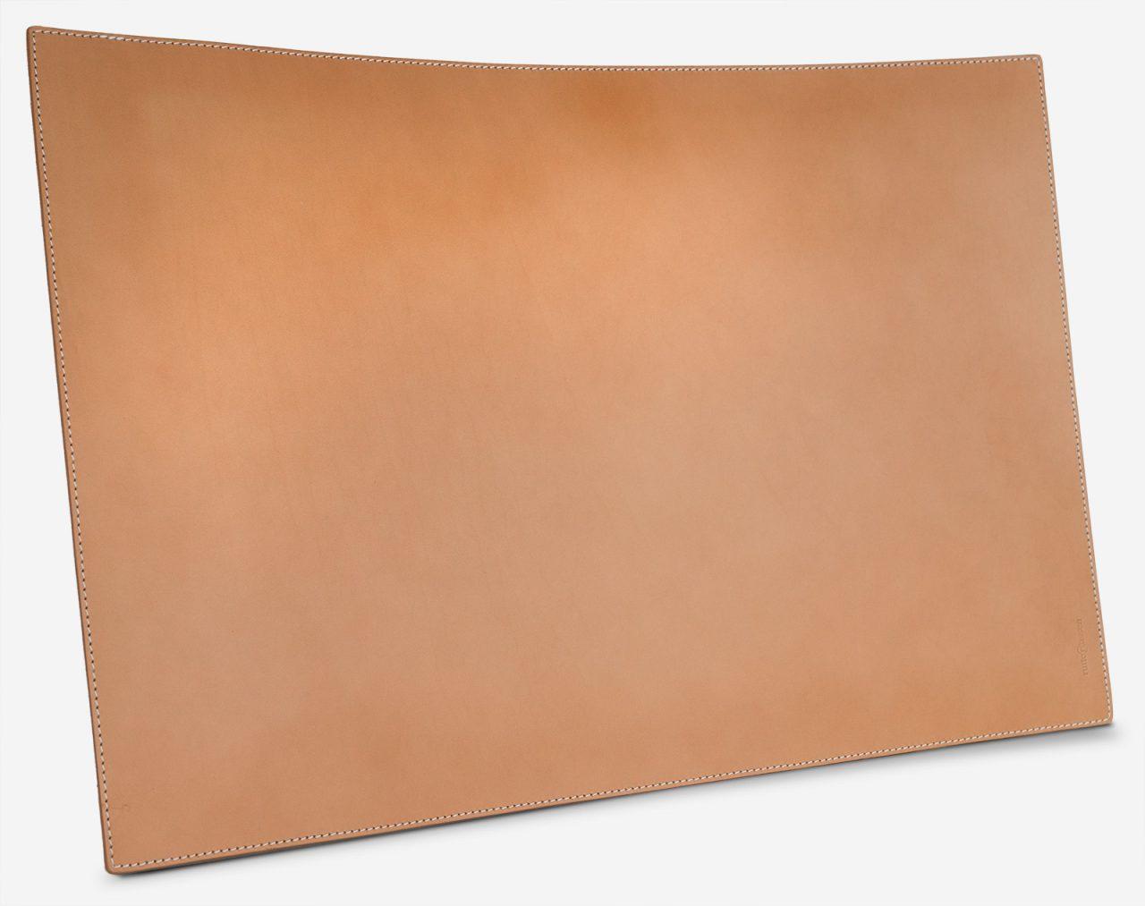 Tan leather writing mat.