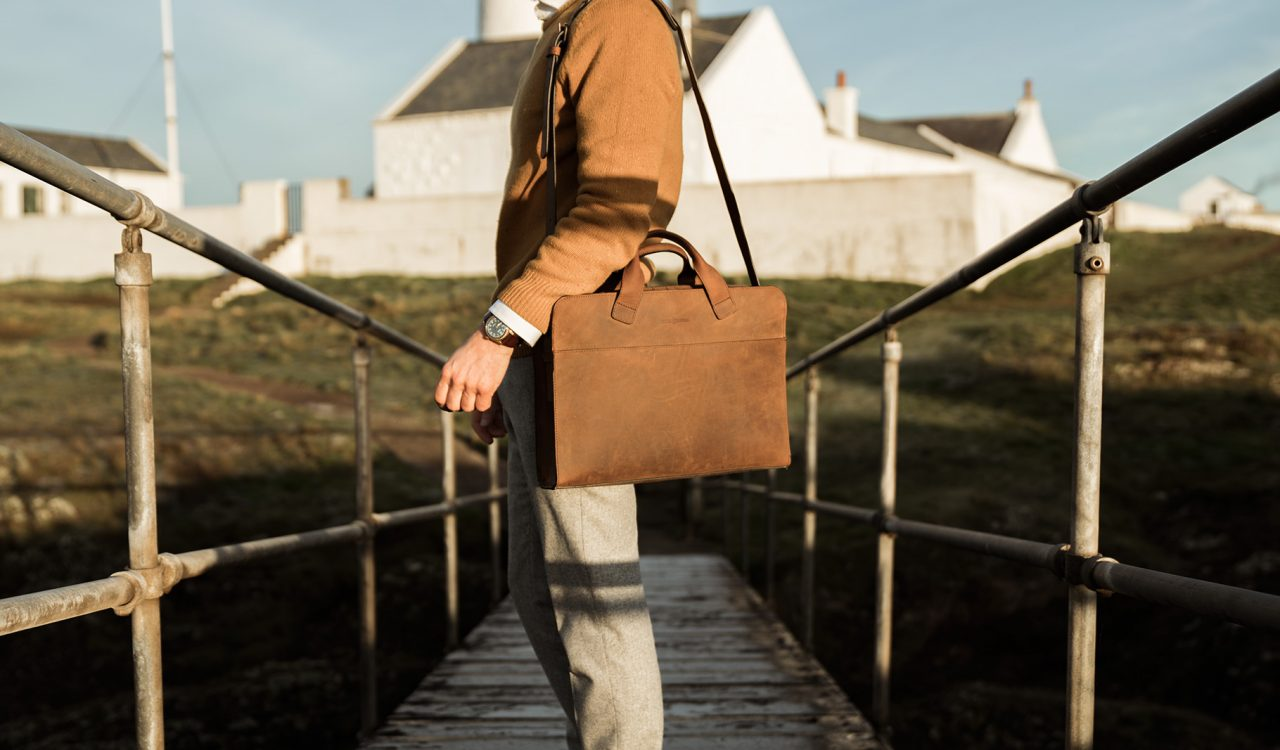 Brown briefcase handmade from full-grain leather.