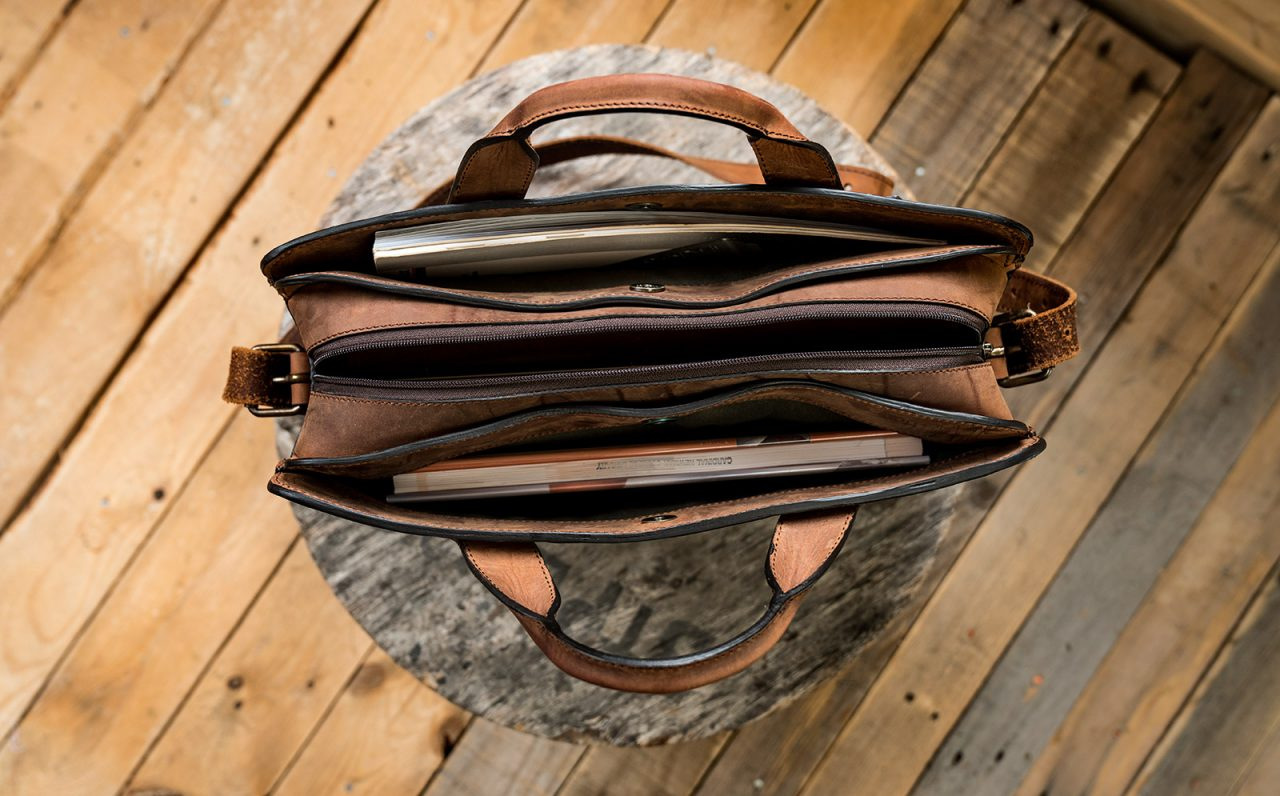 Brown full-grain leather briefcase interior.