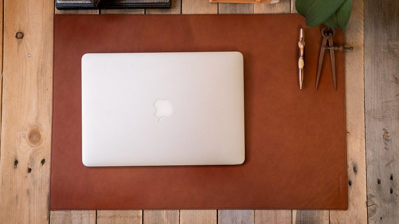 Leather desk mat in office.