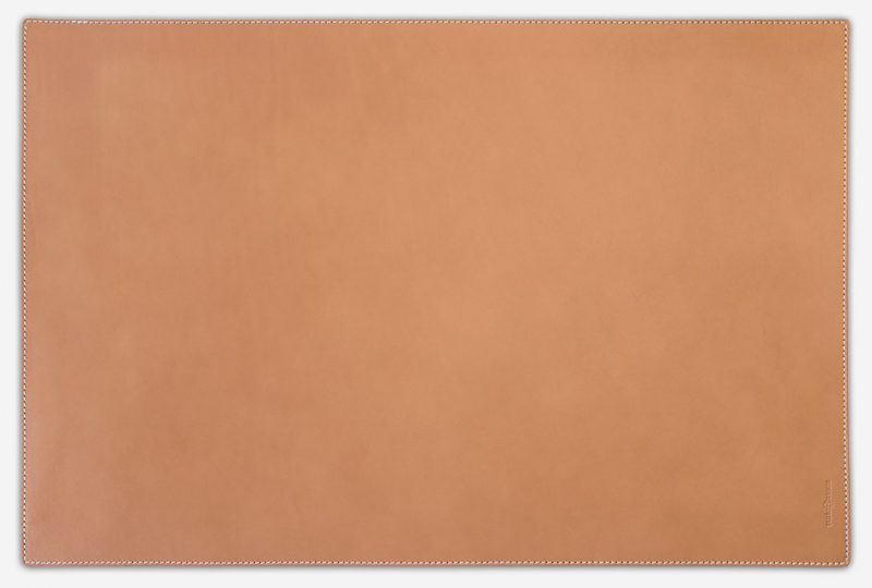 Tan leather writing mat.