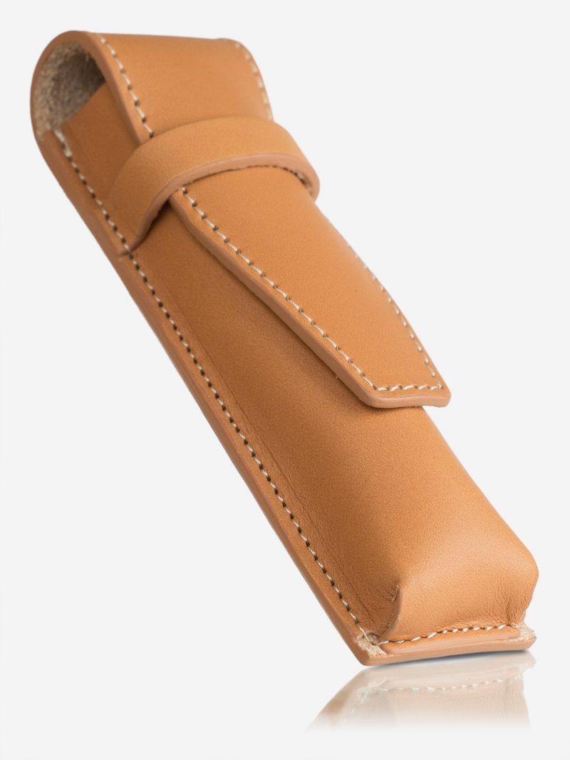 Tan leather pen case.