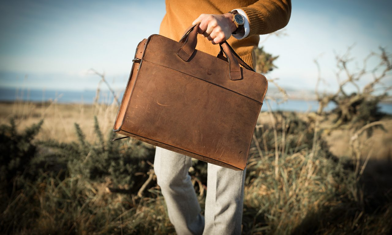 Brown briefcase handmade from vegetable-tanned leather.