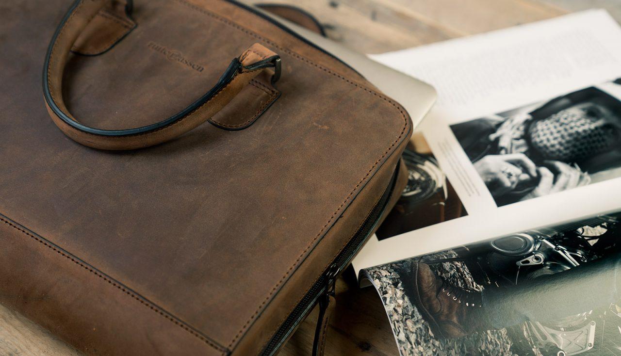 Portfolio bag with magazine.