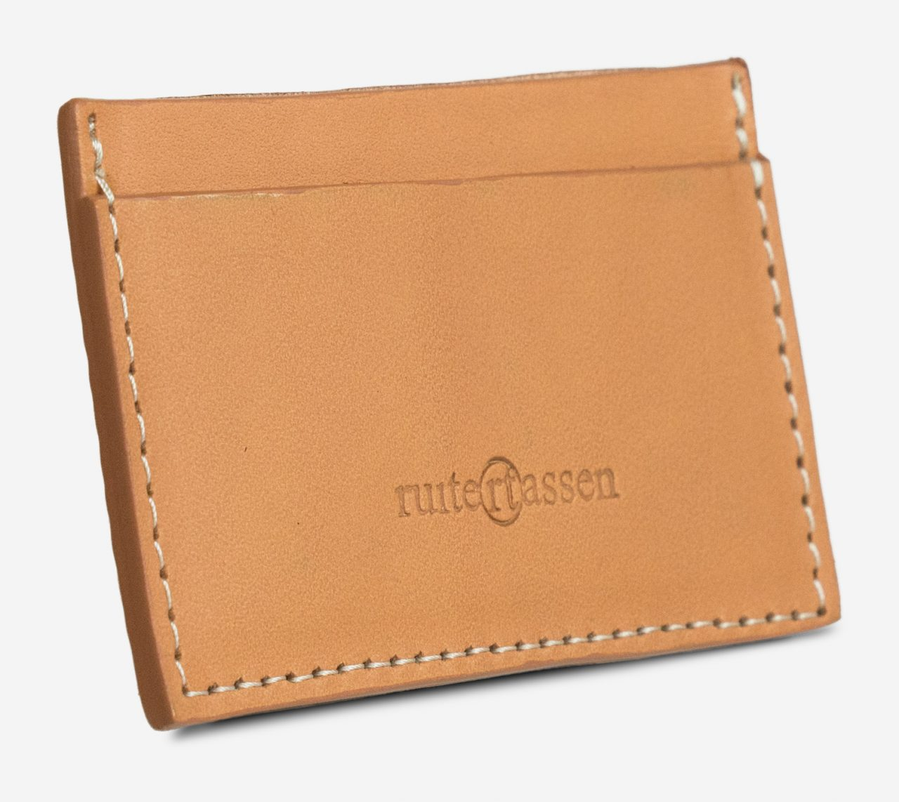tan leather card holder side view.