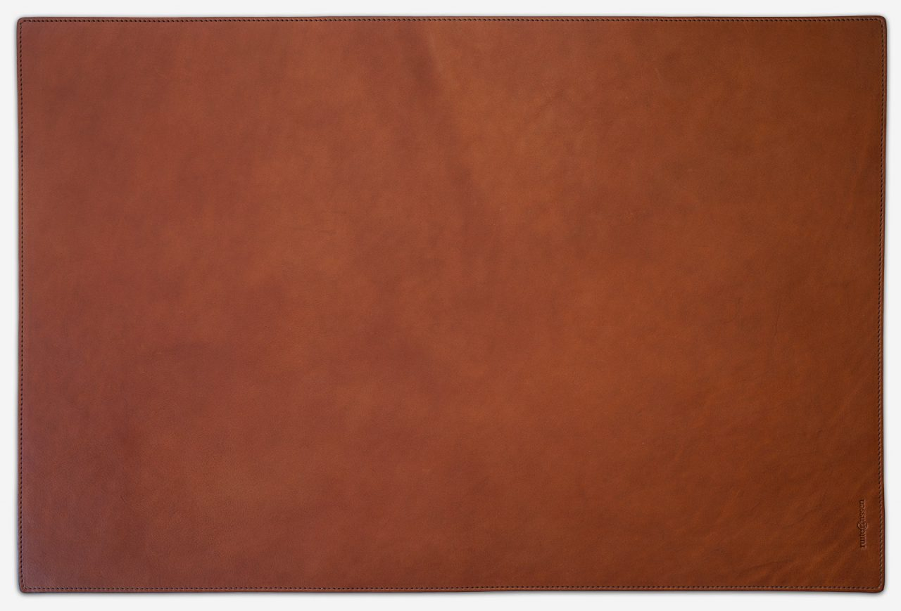 Cognac leather desk writing mat.