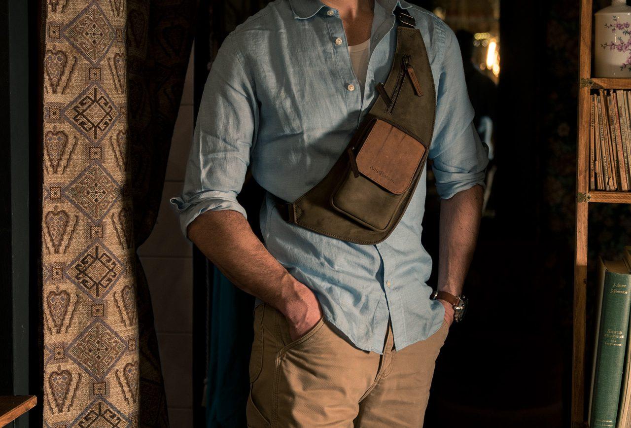 Leather sling bag for men.