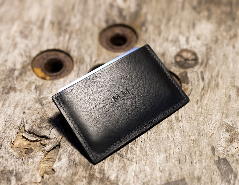 Personalised leather cardholder in black.