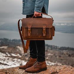 Brown leather camera bag.