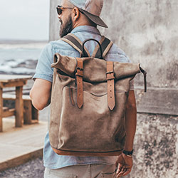 Leather rolltop leather backpack for men.