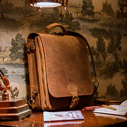 Large vintage leather messenger backpack for men.